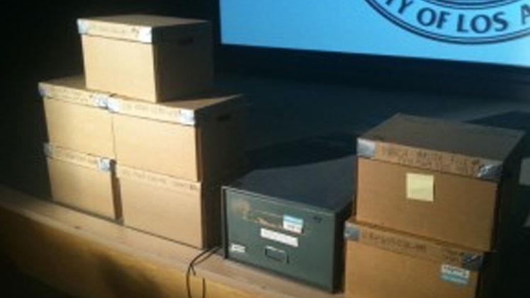 Eight boxes of files on the slain journalist. Photo: Robert J. Lopez